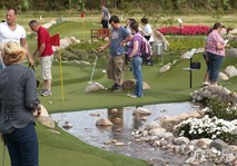People playing Adventure Golf